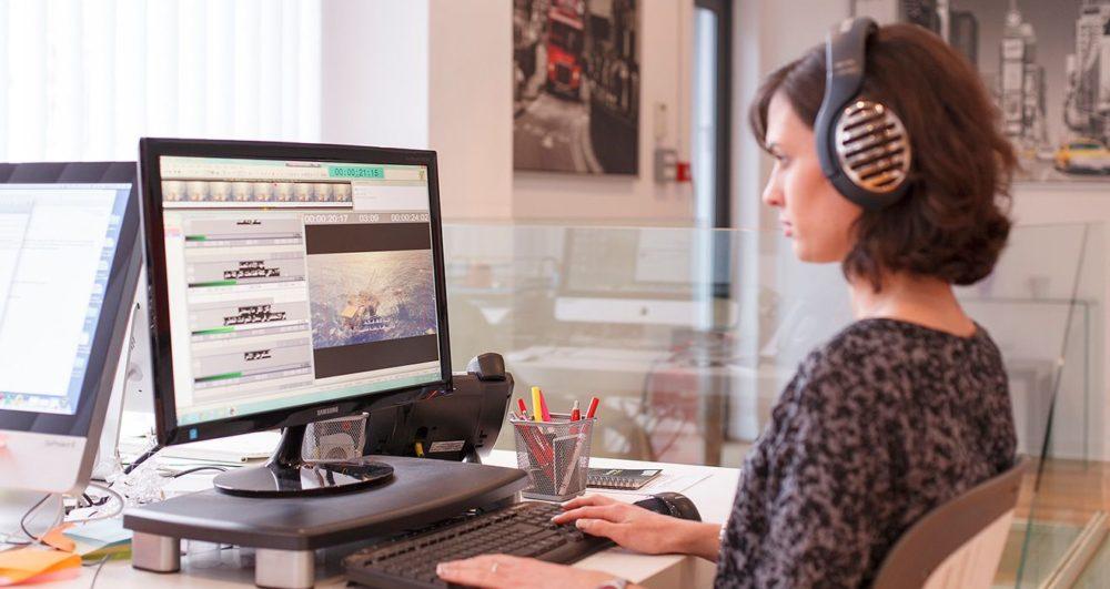 A professional translator translating multimedia audiovisual content